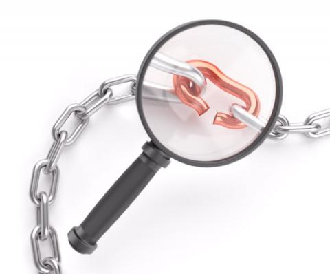Broken Chain Link with Magnifying Glass